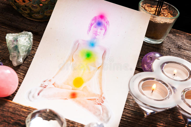 Chakras over a human body. Chakras illustrated over human body with natural crystals royalty free stock images