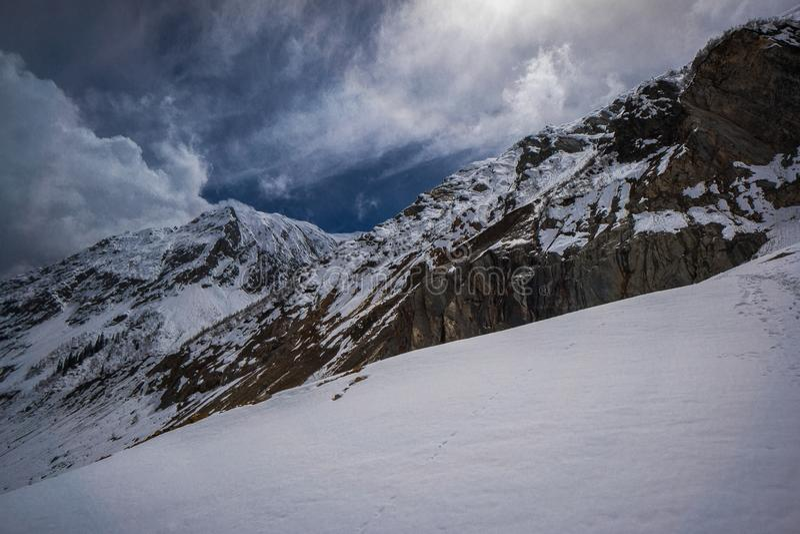 Chalaadi Glacier sun breaking through clouds royalty free stock photo