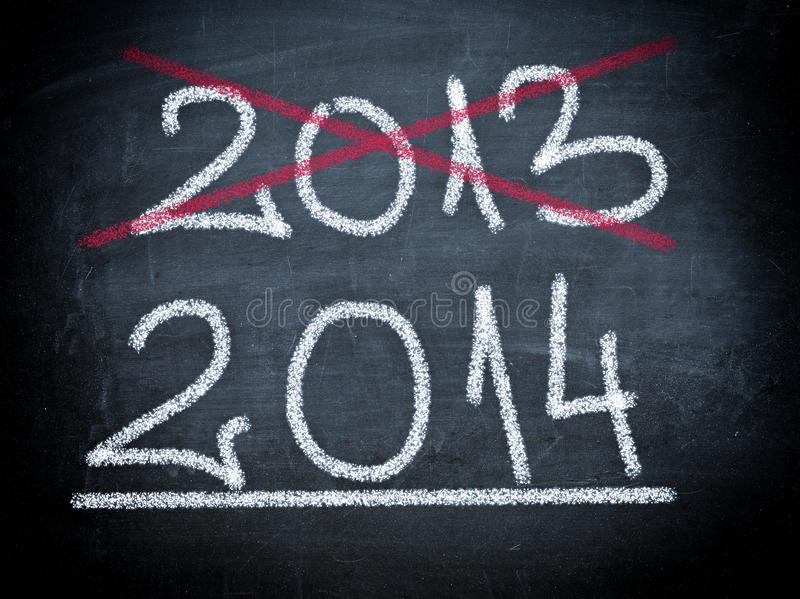 2014 on chalboard. Blackboard with crossed 2013 and 2014 writed with chalk royalty free stock image
