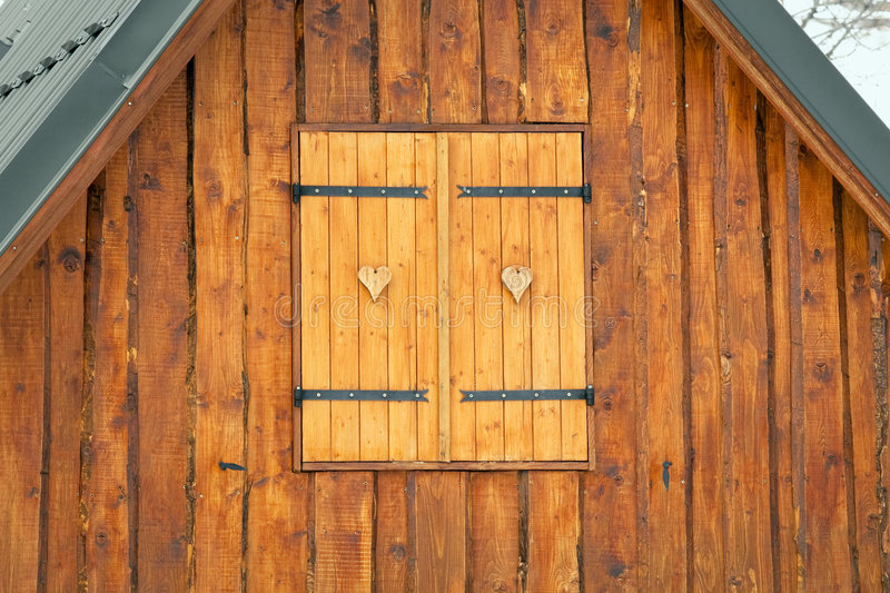 Chalet. Heart shaped decoration on window of chalet stock image