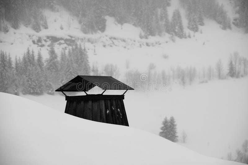 Chalet chimney under the snow royalty free stock photo