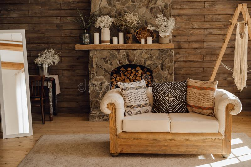 Chalet Cozy Interior Wooden Sofa and Fireplace royalty free stock photo