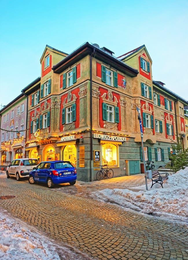 Chalets of Bavarian style decorated for Christmas at Garmisch Partenkirchen. Garmisch-Partenkirchen, Germany - January 6, 2015: Chalets of Bavarian style royalty free stock photo
