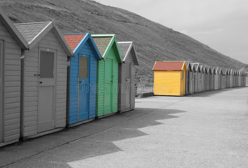 Chalets black and white. Isolation of blue,green and yellow chalets stock images