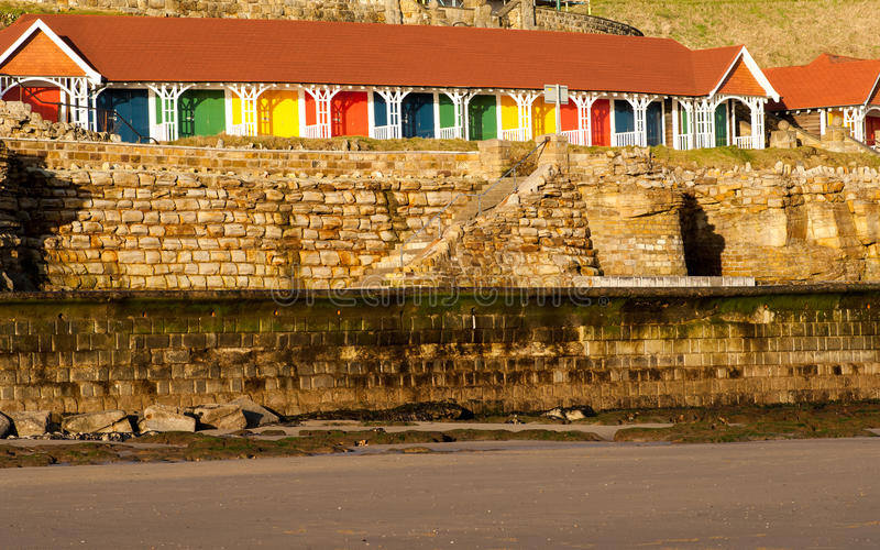 Chalets at the coast. Multi-coloured tourist chalets illiuminated by early morning sun royalty free stock photography