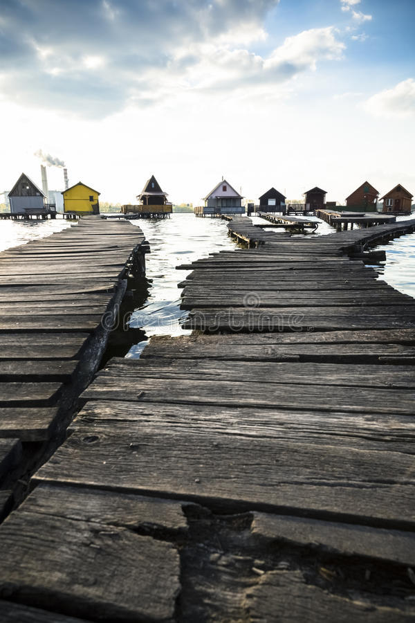 Chalets, cottages on the shore of a lake. Cottages on the shore of a lake royalty free stock image