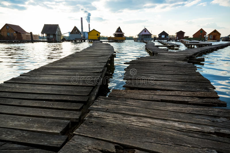 Chalets, cottages on the shore of a lake. Cottages on the shore of a lake stock photography