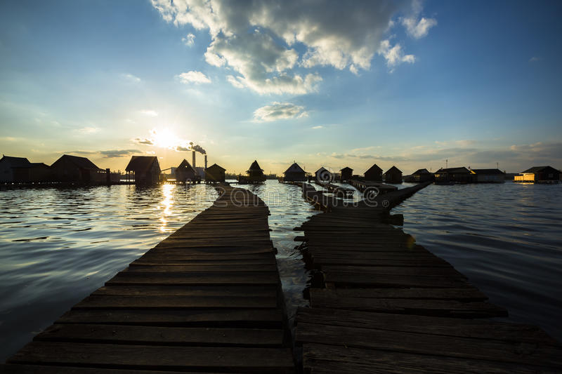 Chalets, cottages on the shore of a lake. Cottages on the shore of a lake stock photos