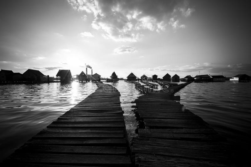 Chalets, cottages on the shore of a lake. Cottages on the shore of a lake royalty free stock images
