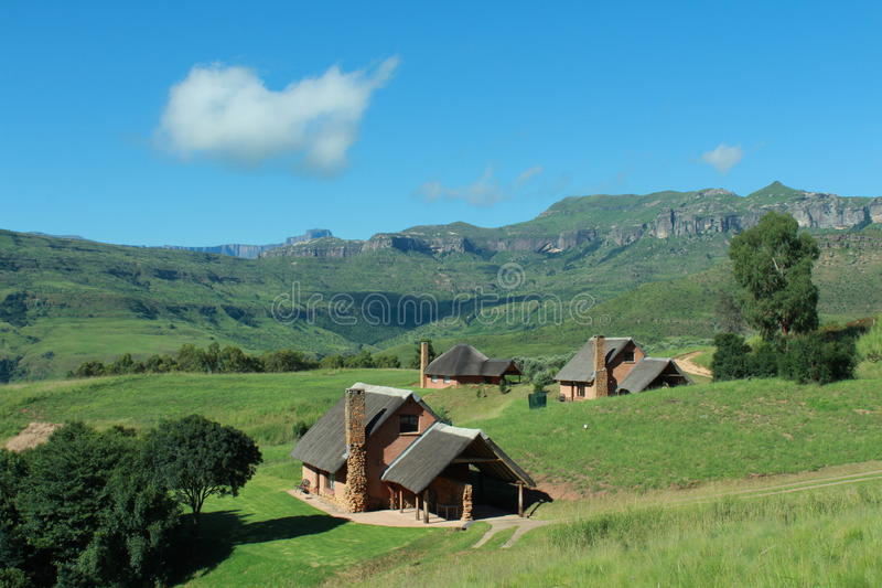 Chalets in Drakensberg Mountains. Chalet lodges in Drakensberg Mountains, sunny weather blue skies royalty free stock photo