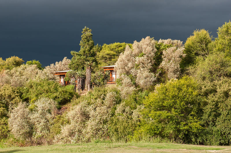 Chalets in Lang Elsies Kraal restcamp. Situated on the banks of the Breede River in the Bontebok National Park near Swellendam, Western Cape Province of South stock photography