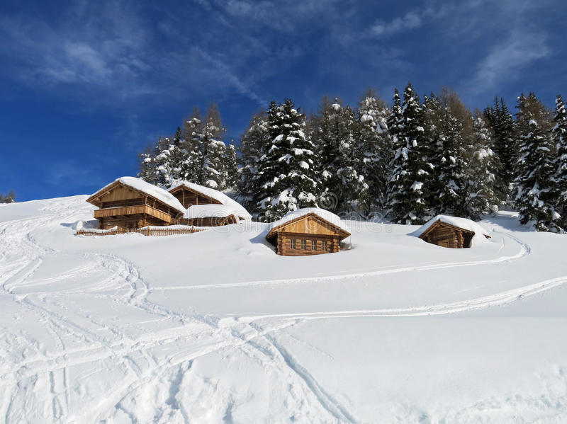 Chalets and mountain houses in the middle of the snow high in th. E italian Dolomites stock images