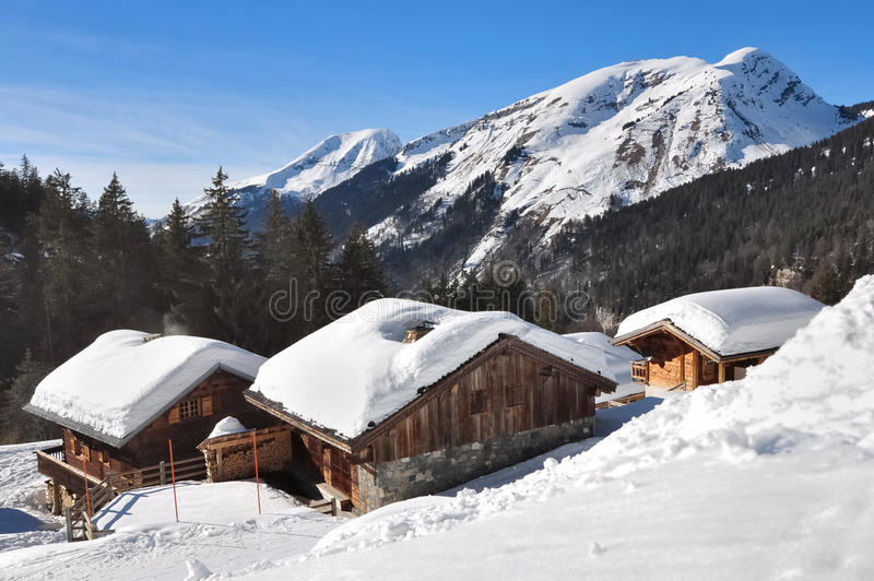 Chalets in the mountains. Covered with snow royalty free stock photography