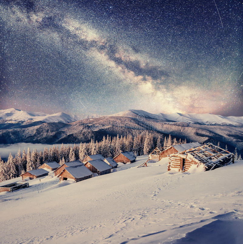 Chalets in the mountains at night under the stars royalty free stock image