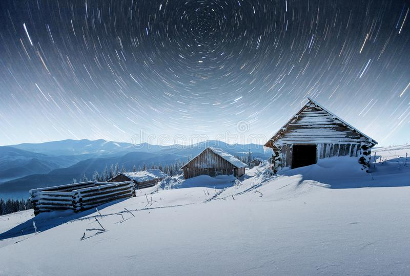 Chalets in the mountains at night under the stars. Magic event in frosty day. In anticipation of the holiday. Dramatic. Scenes. Carpathians, Ukraine, Europe stock image