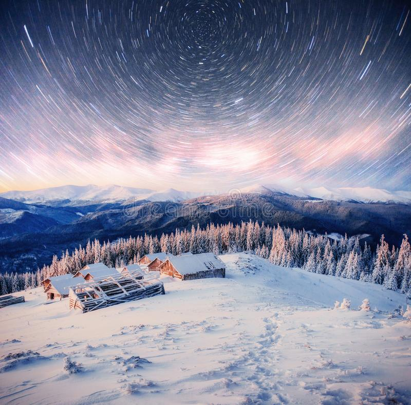 Chalets in the mountains at night under the stars. Magic event in frosty day. In anticipation of the holiday. Dramatic. Scenes. Carpathians, Ukraine, Europe stock photo