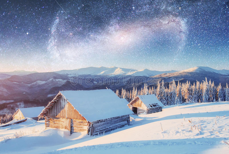 Chalets in the mountains at night under the stars. Magic event i. Chalets in the mountains at night under the stars. Courtesy of NASA. Magic event in frosty day royalty free stock images
