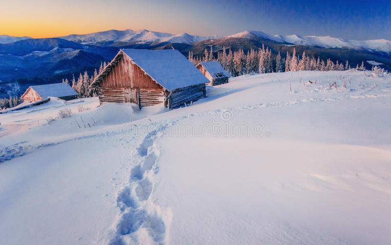 Chalets in the mountains at sunset. Carpathian, Ukraine, Europe. Chalets in the mountains at sunset. Carpathian Ukraine. Europe stock photography