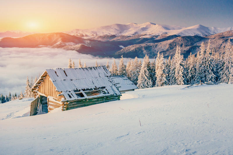 Chalets in the mountains at sunset. Winter greetings royalty free stock photography