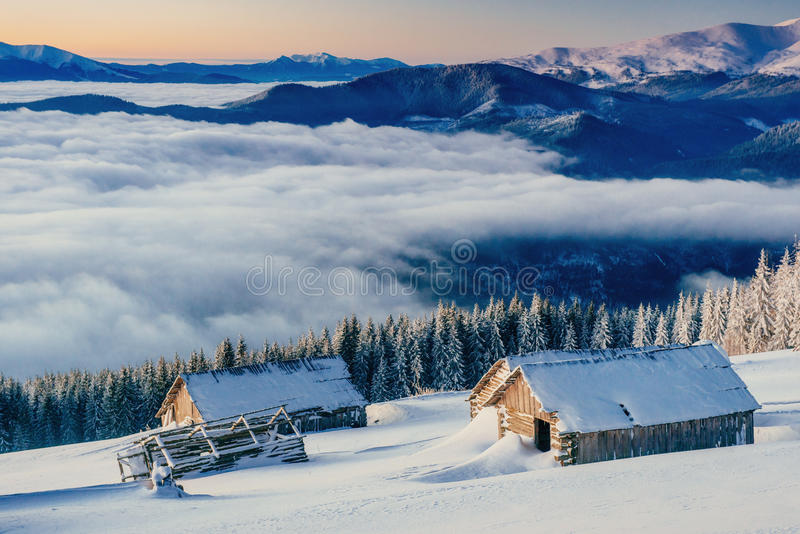 Chalets in the mountains at sunset. Winter greetings stock images