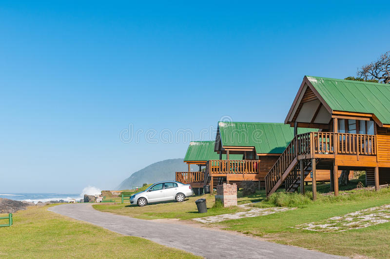 Chalets overlooking the sea. STORMS RIVER MOUTH, SOUTH AFRICA - FEBRUARY 29, 2016: Chalets overlooking the Indian Ocean at Storms River Mouth Rest Camp stock photography