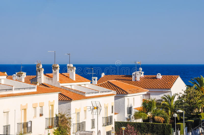 Chalets beside the sea. Summer vacations concept. Small mediterranean snug resort town on Costa Dorada, Spain. Chalets beside the sea. Summer vacations concept royalty free stock image