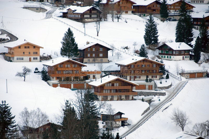 Chalets in the Snow. Chalets in the Swiss town of Grindelwald stock image