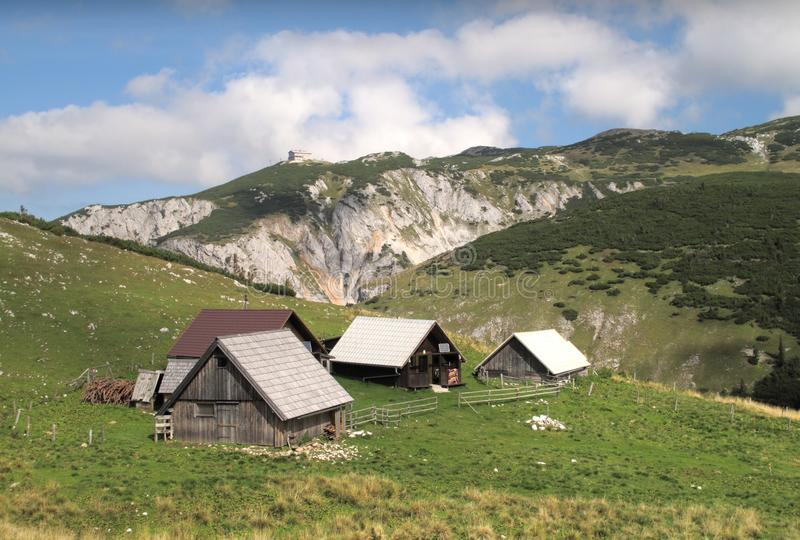 Chalets on the way from Heukuppe to Habsburk hut. Several chalets on plateau of Rax Alps on the way from summit of Heukuppe to Habsburk mountain hut royalty free stock images