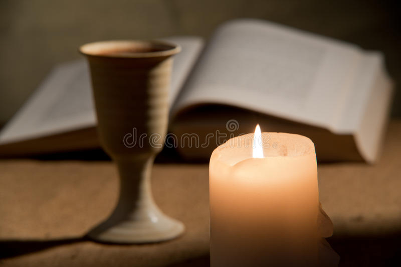 Chalice of wine and bible. Still life with bible and chalice of wine royalty free stock photography