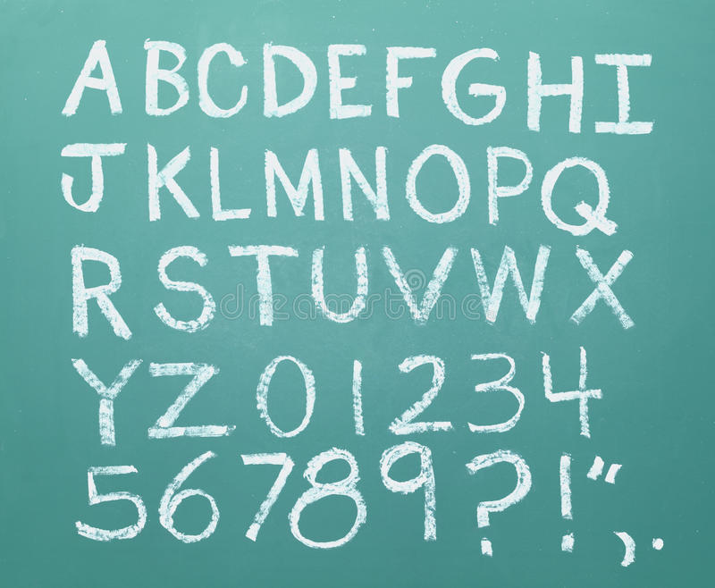 Chalk Alphabet. All the letters of the alphabet drawn in chalk on a green chalkboard stock image