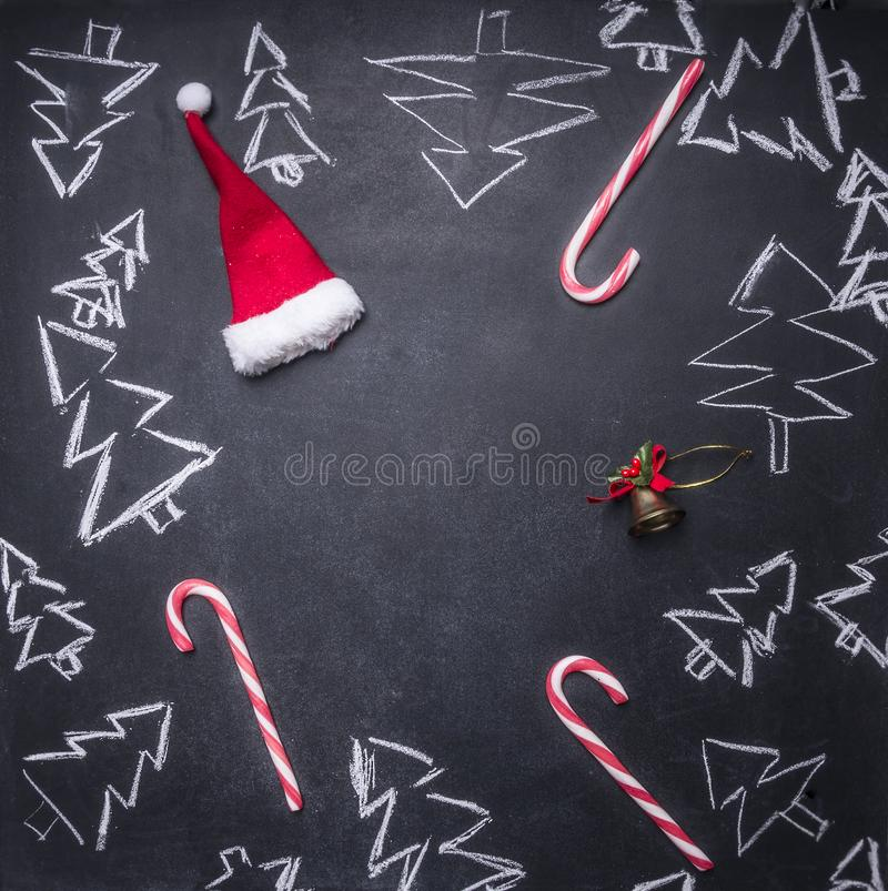 chalk board painted Christmas decorations, Christmas trees, candy, cups and ingredients for mulled wine, tiled frame, space f stock photos