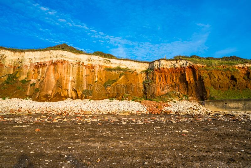Chalk and brownstone cliffs on the beach in Hunstanton, Norfolk royalty free stock photography