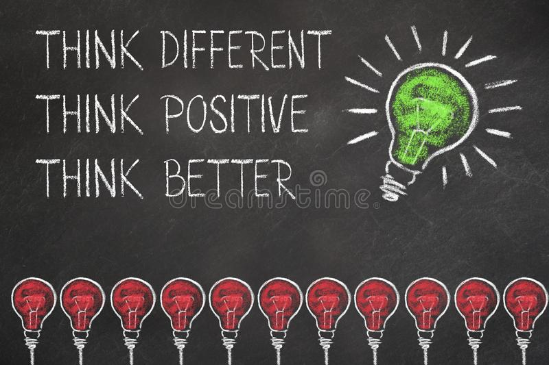 Chalk bulb idea on a blackboard with text think different, positive and better royalty free illustration