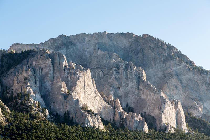 Chalk cliffs of Mt Princeton Colorado. Steep jagged spikes of chalk white cliffs of Mount Princeton near Buena Vista in Colorado shortly after sunrise as the sun stock images