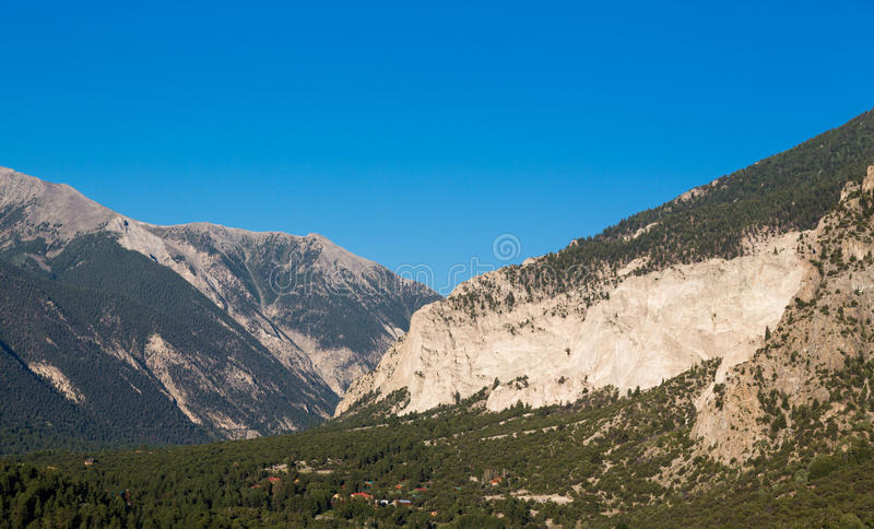 Chalk cliffs of Mt Princeton Colorado. Valley of chalk white cliffs of Mount Princeton near Buena Vista in Colorado shortly after sunrise as the sun first lights stock photos