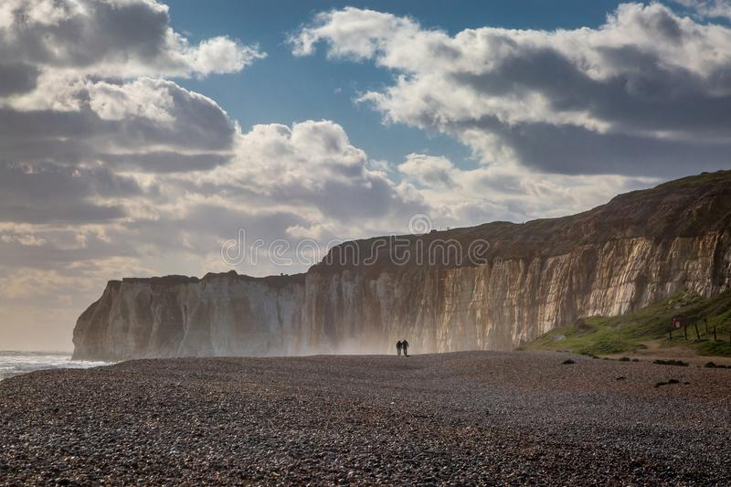 Newhaven Beach. The chalk cliffs and pebble beach at Newhaven in Sussex on a windy spring day royalty free stock images