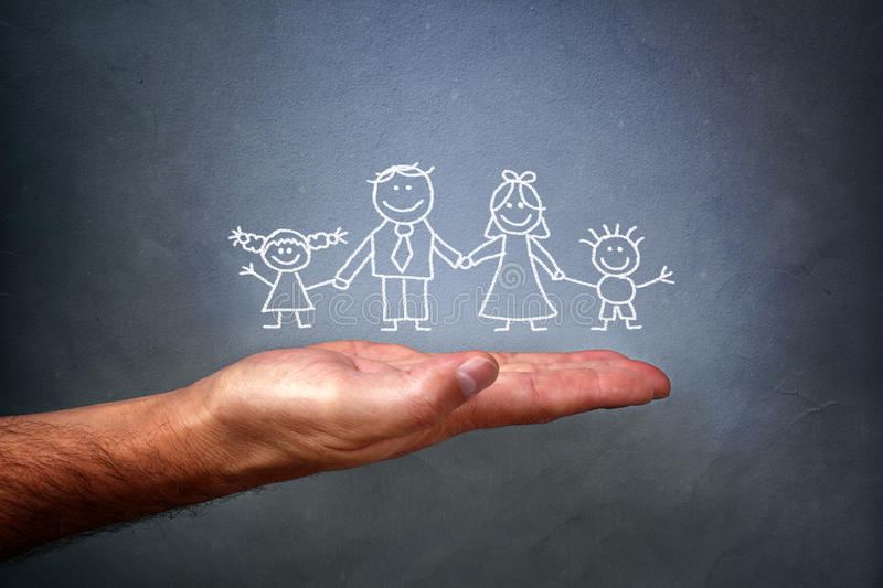 Chalk drawing of a family. Children's chalk drawing on a blackboard of a happy family with mom, dad, son and daughter holding hands being held in the palm of a royalty free stock photos