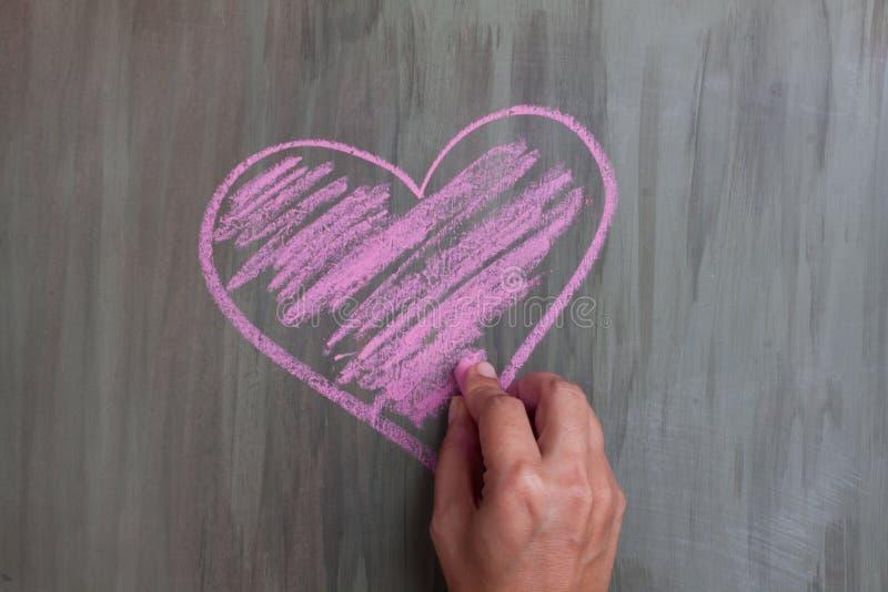 Chalk drawing heart shape. Chalk drawing pink heart shape stock photography