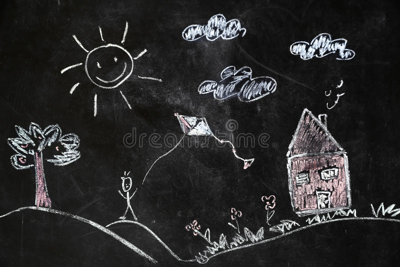 Chalk drawing of house and sun on a black background, stock image
