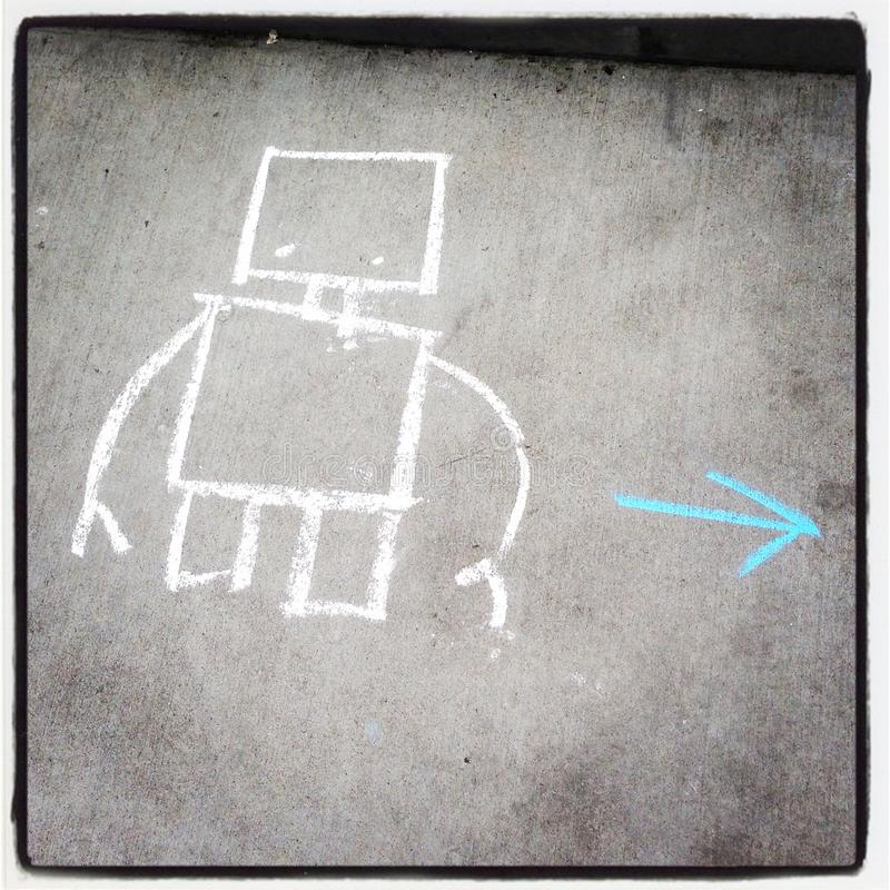 A chalk drawing of a robot with an arrow pointing stock photos