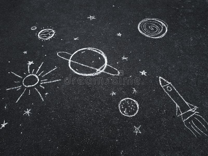 Chalk drawing. Space, planets and stars painted by children`s. stock images