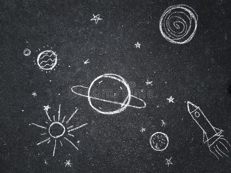 Chalk drawing. Space, planets and stars painted by children`s. Chalk drawing. Space, planets and stars painted by children`s stock image