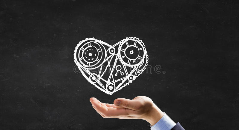 Chalk drawn mechanism. Person hand and chalk drawing of heart stock images