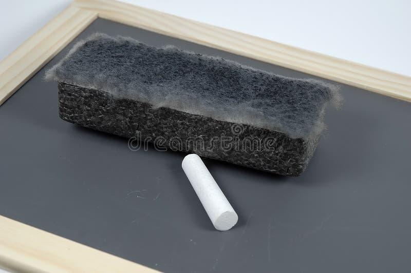Chalk and Eraser stock photos