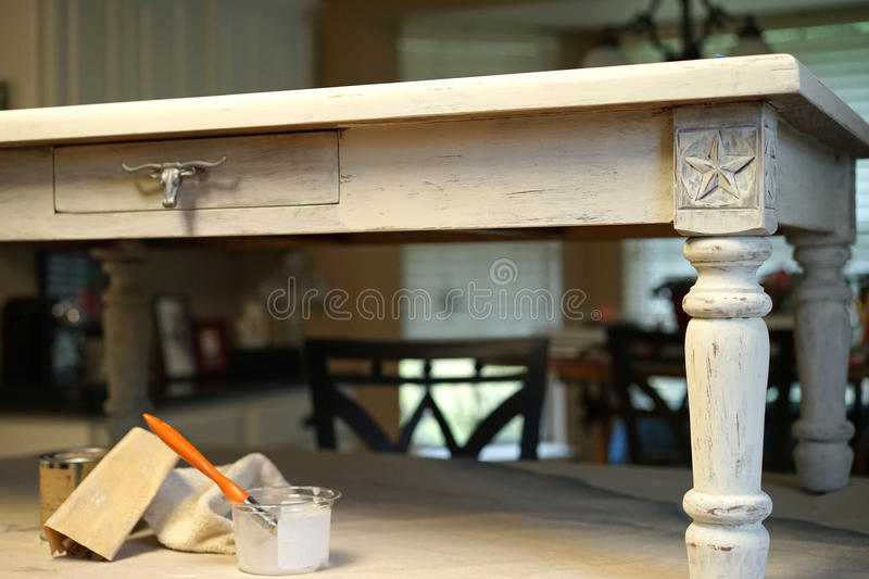 Chalk paint and sandpaper table project. This western coffee table was lightened with chalk paint and distressed with sandpaper to bring out fine details like royalty free stock photography