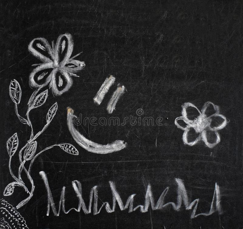 Chalk paintings on a black board stock images