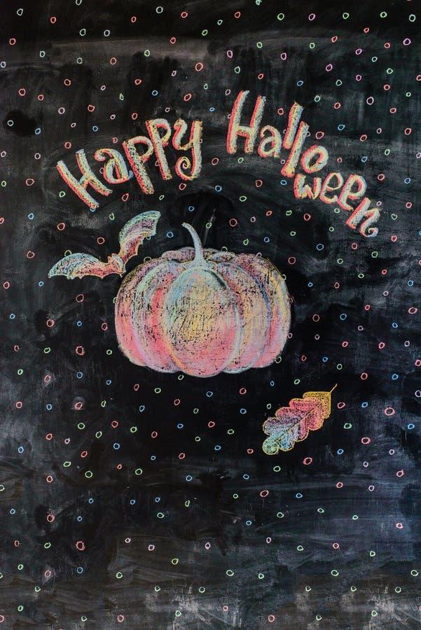 Chalk picture happy halloween. Chalk pattern of happy halloween on slate stock photo