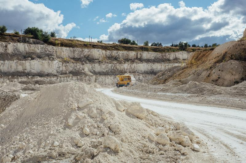 Chalk quarry. Moving dump truck loaded with chalk.  royalty free stock photography