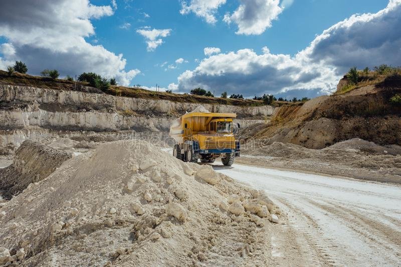 Chalk quarry. Moving dump truck loaded with chalk.  stock photos