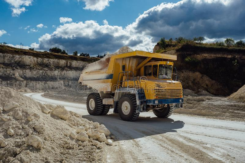 Chalk quarry. Moving dump truck loaded with chalk.  royalty free stock images